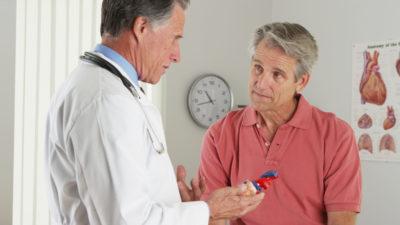 Senior doctor explaining heart to elderly patient