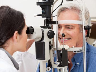 Optometrist performing visual field test